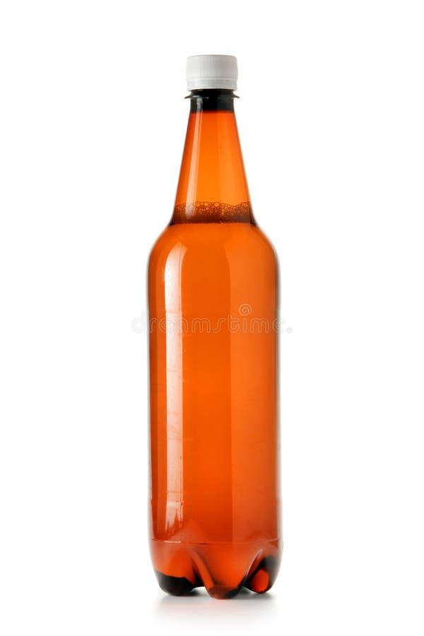 Botella de cerveza plástica imagenes de archivo