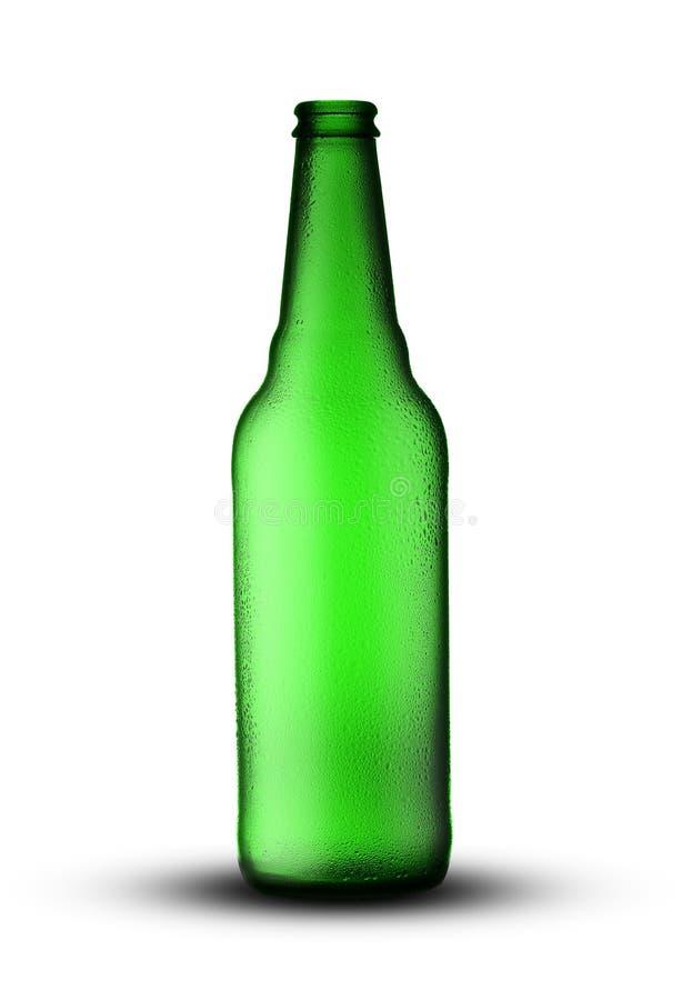 Botella de cerveza verde vac?a fotografía de archivo