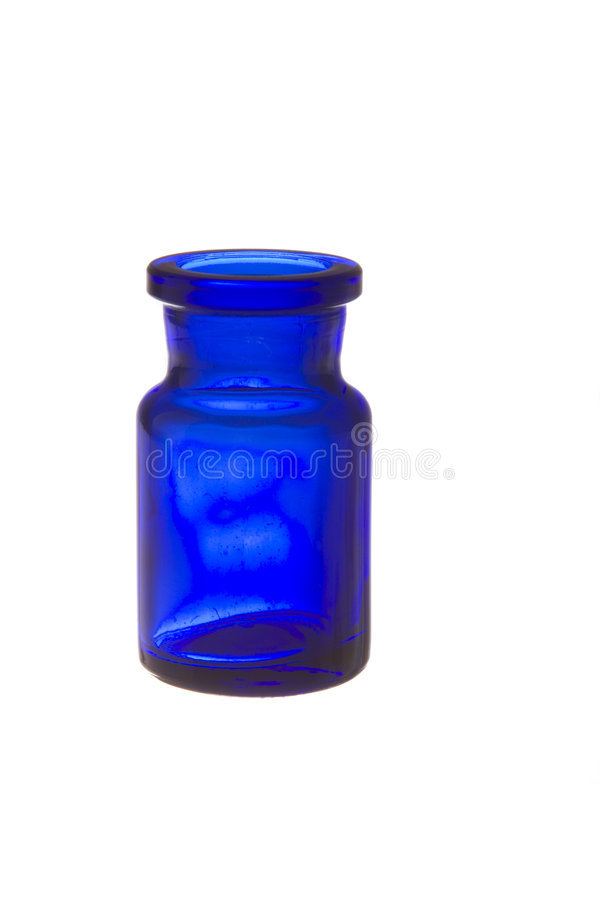 Botella de cristal azul con spi de la tinta fotos de archivo libres de regalías