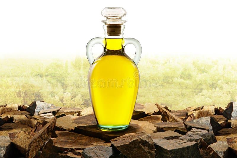 Botella de cristal del aceite de oliva con aceite de oliva imagenes de archivo
