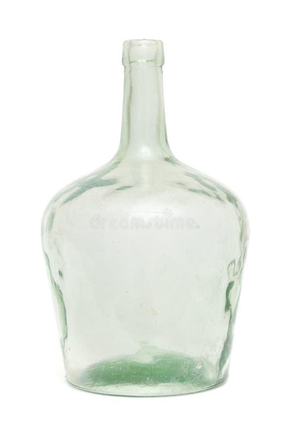 Botella de cristal verde sucia vieja imagen de archivo