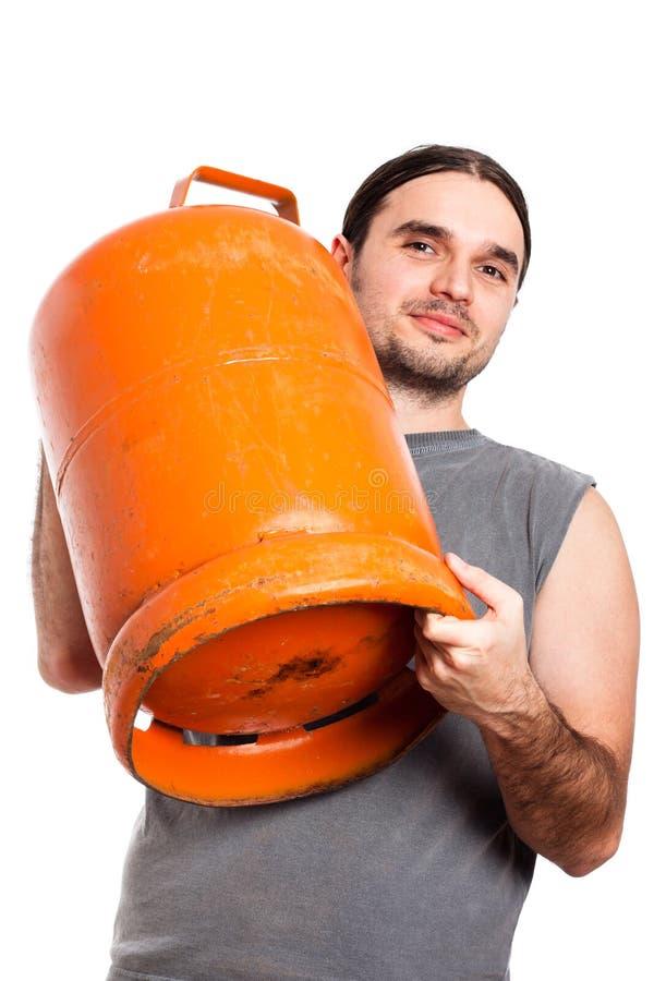 Botella de gas de la explotación agrícola del hombre fotografía de archivo libre de regalías