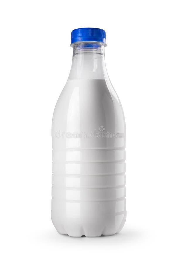 Botella de leche aislada en el fondo blanco imagenes de archivo