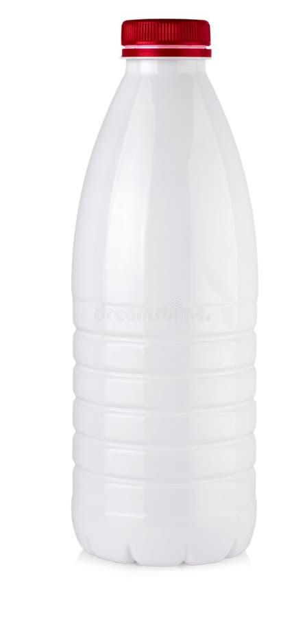 Botella de leche plástica en un fondo blanco fotos de archivo