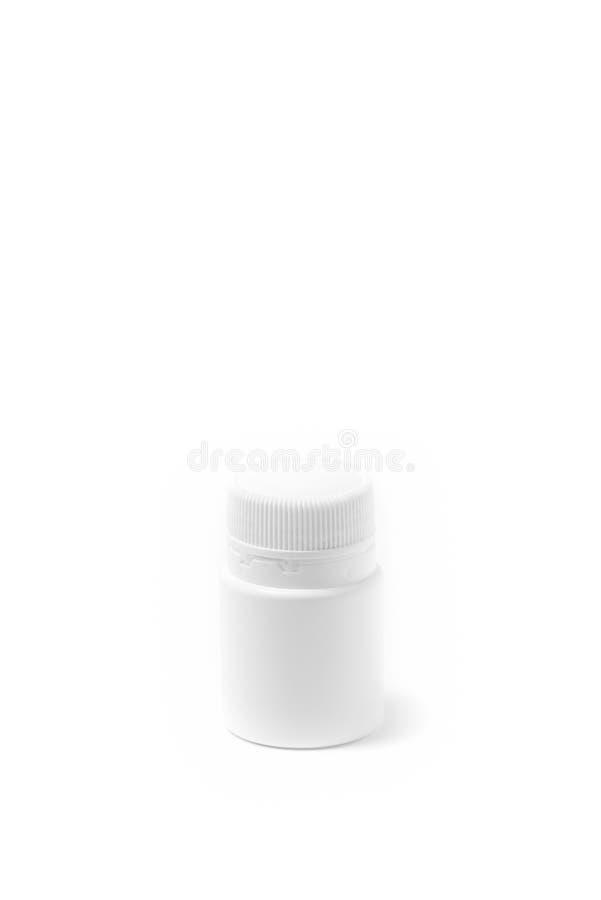Botella de píldora blanca de la medicina aislada en el fondo blanco Droga, ejemplo fotos de archivo