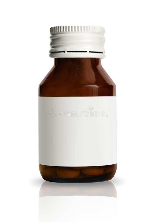 Botella de píldora con la escritura de la etiqueta en blanco fotografía de archivo