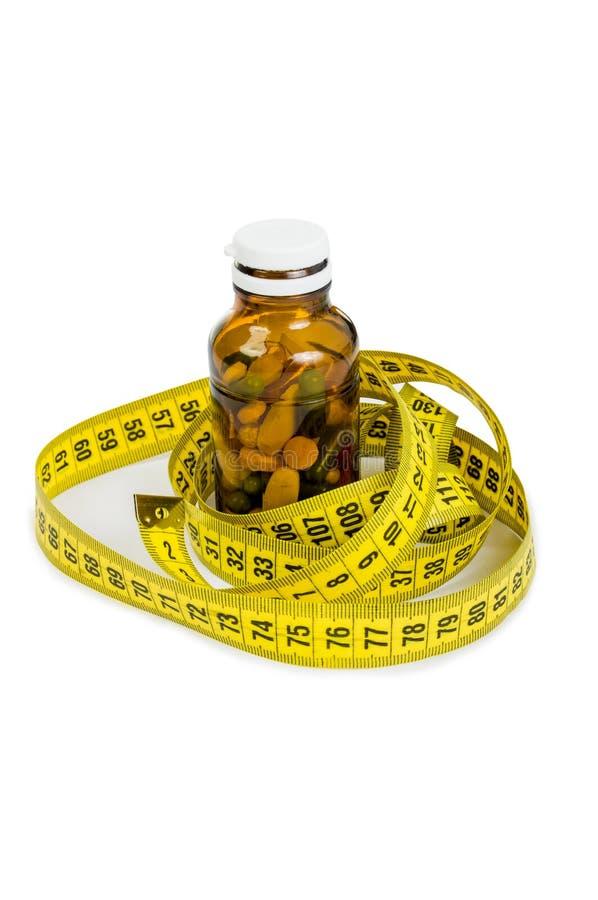 Botella de píldoras y de metro imagenes de archivo