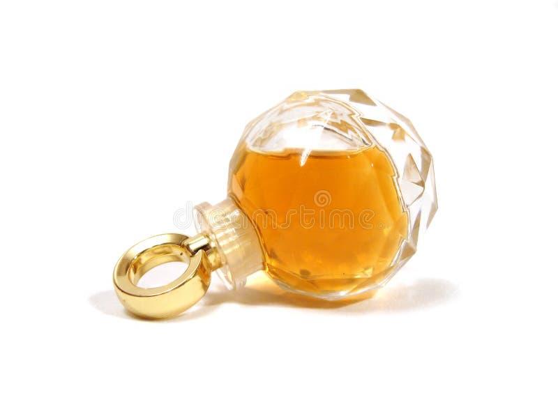 Botella de perfume sobre el fondo blanco imagenes de archivo