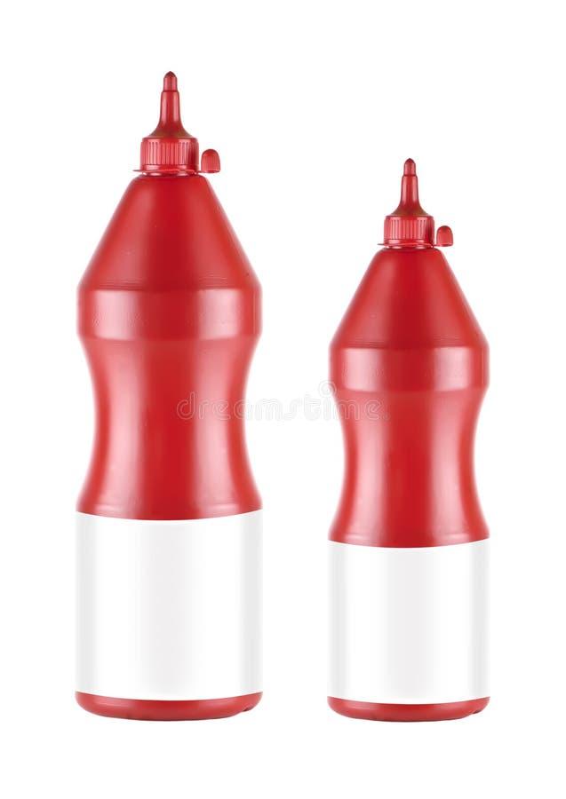 Botella de salsa de tomate de dos plásticos fotografía de archivo libre de regalías