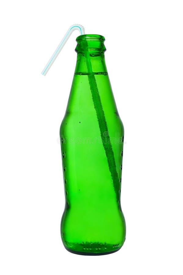 Botella de soda con la paja fotografía de archivo