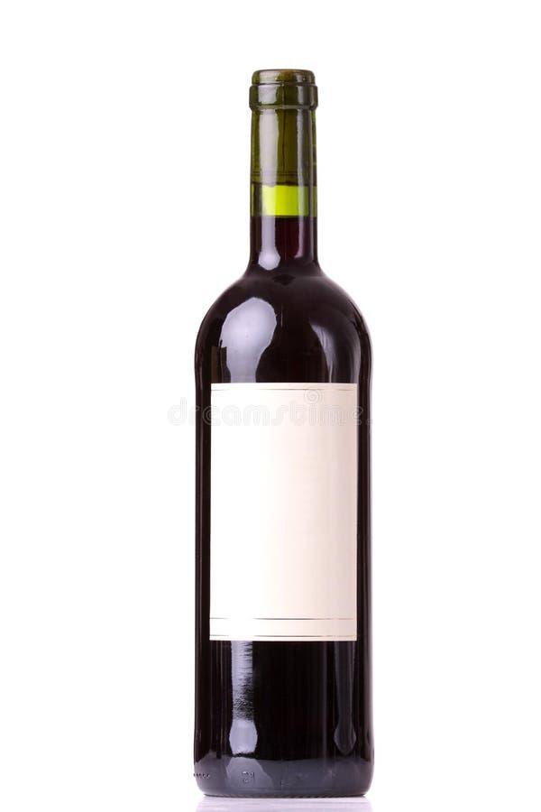 Botella de vino rojo con las escrituras de la etiqueta en blanco foto de archivo libre de regalías