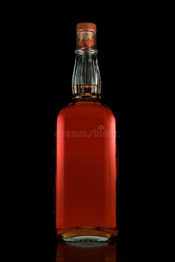 Botella de whisky llena imágenes de archivo libres de regalías