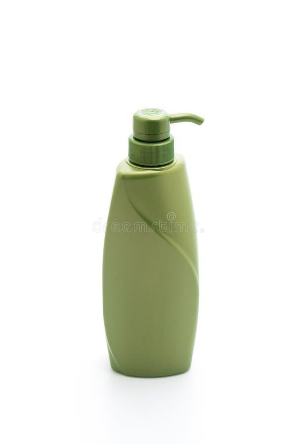 botella del acondicionador del champ? o de pelo en el fondo blanco fotos de archivo libres de regalías