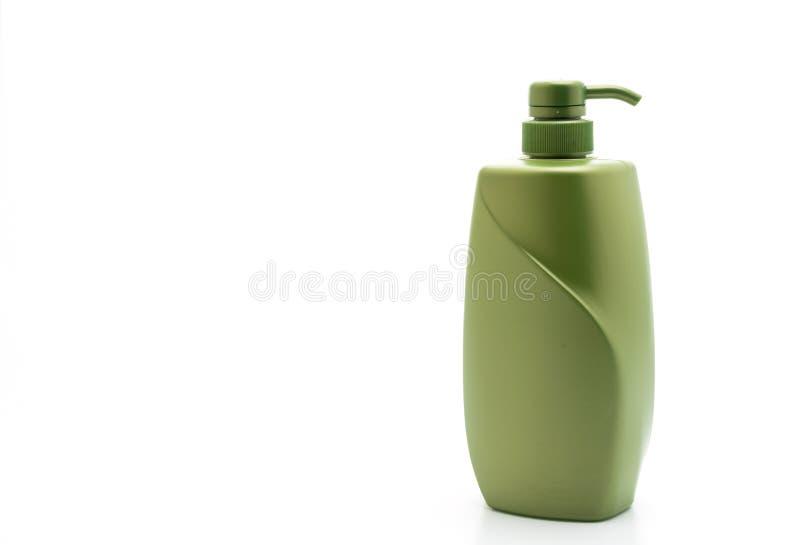 botella del acondicionador del champ? o de pelo en el fondo blanco imagen de archivo