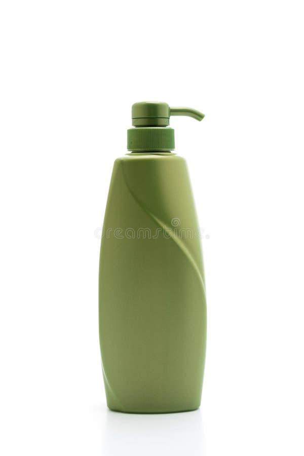 botella del acondicionador del champ? o de pelo en el fondo blanco imágenes de archivo libres de regalías