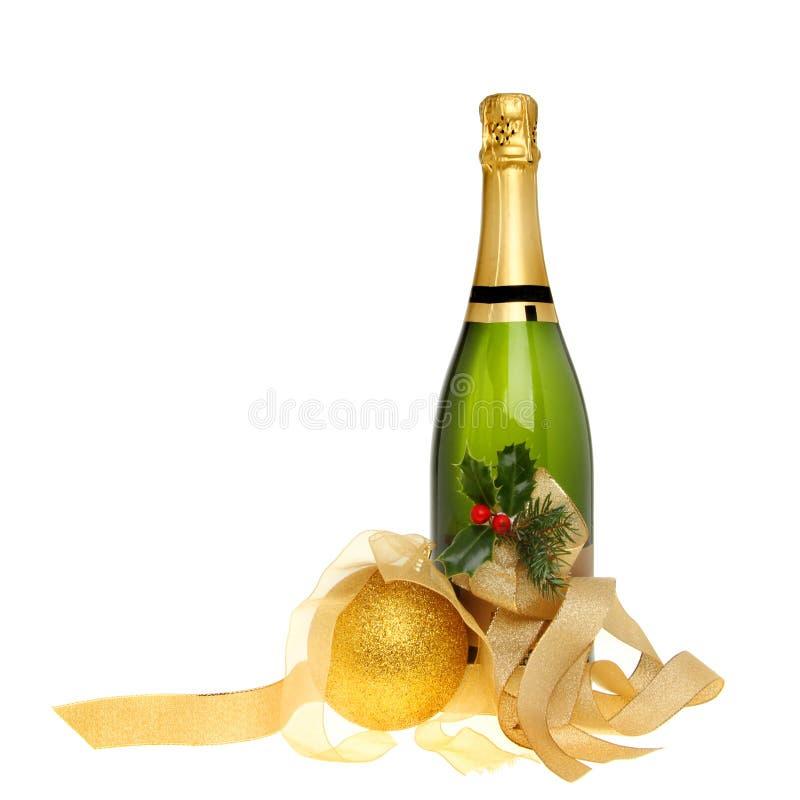 Botella del champán de la Navidad imagen de archivo libre de regalías