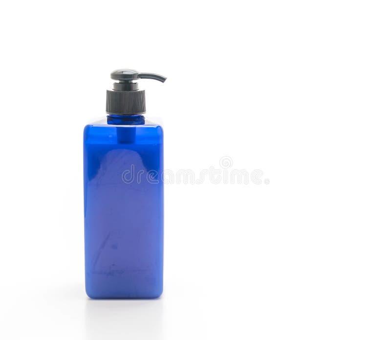 botella del champú o del jabón en el fondo blanco foto de archivo libre de regalías