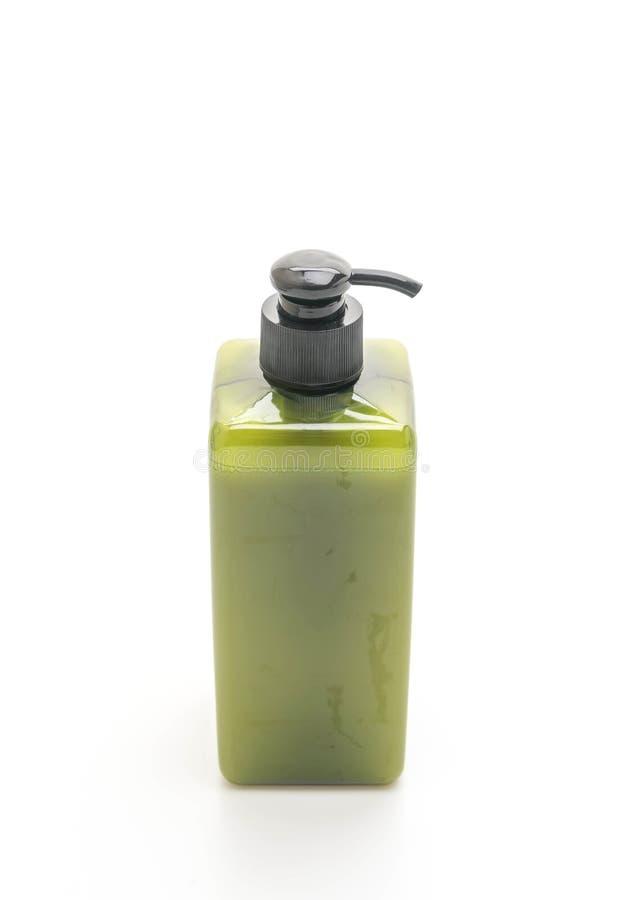 botella del champú o del jabón en el fondo blanco fotos de archivo