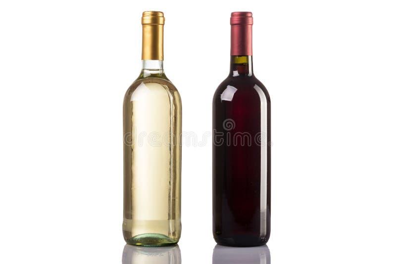 Botella del vino blanco rojo y en el fondo blanco fotografía de archivo