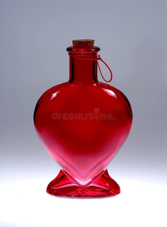 Botella en forma de corazón foto de archivo