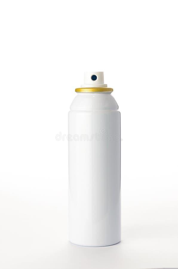 Botella metálica del espray en el fondo blanco fotografía de archivo libre de regalías