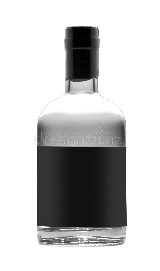 Botella negra de whisky aislada imagen de archivo