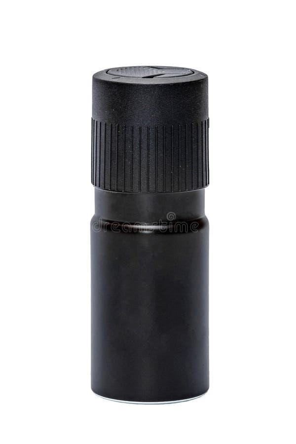 Botella negra del espray de aerosol de desodorante en el primer blanco del fondo imágenes de archivo libres de regalías