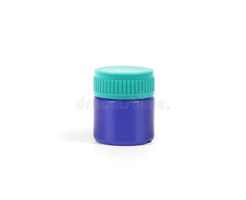 Botella plástica de la medicina de los azules marinos fotos de archivo