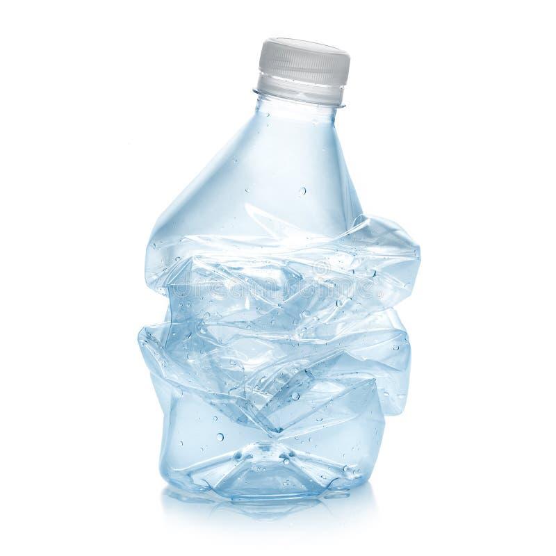 Botella plástica machacada fotos de archivo