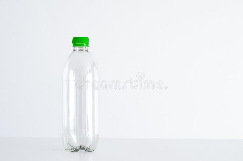 Botella plástica vacía imágenes de archivo libres de regalías