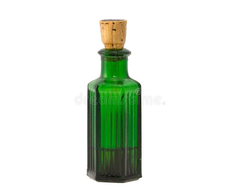 Botella química verde pasada de moda foto de archivo libre de regalías