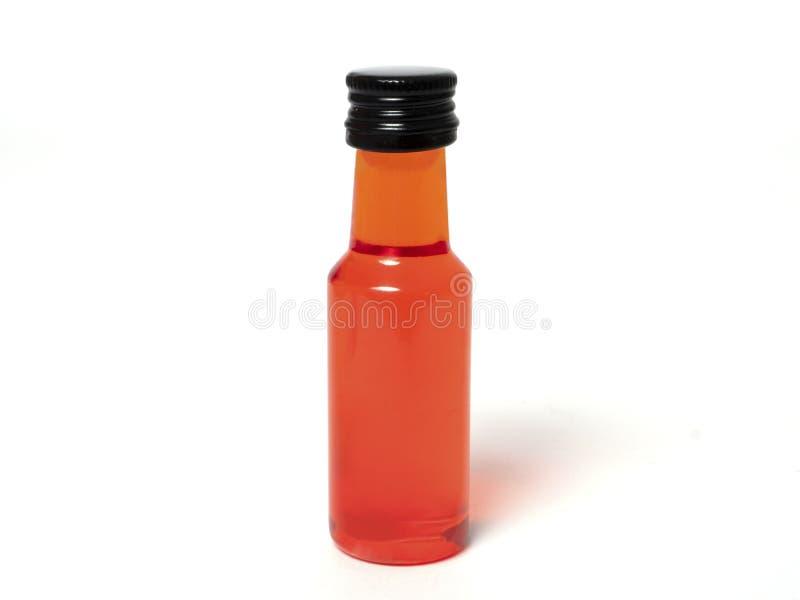 Botella roja en el fondo blanco imágenes de archivo libres de regalías