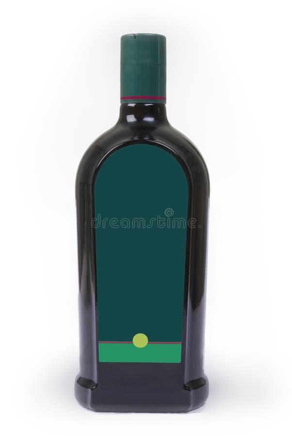 Botella verde con la escritura de la etiqueta en blanco fotografía de archivo libre de regalías