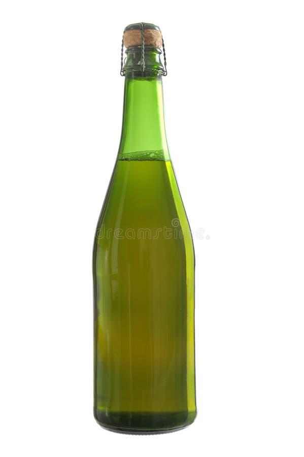 Botella verde de sidra imágenes de archivo libres de regalías