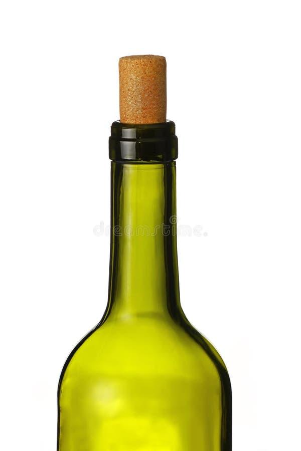 Botella verde de vino con el corcho aislado en blanco foto de archivo libre de regalías