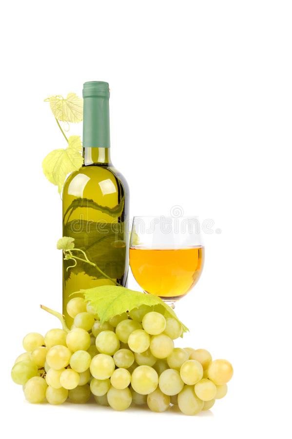 Botella, vidrio y uvas de vino imagen de archivo