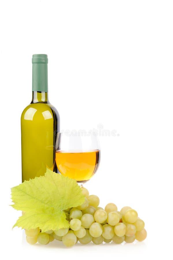 Botella, vidrio y uvas de vino fotos de archivo libres de regalías