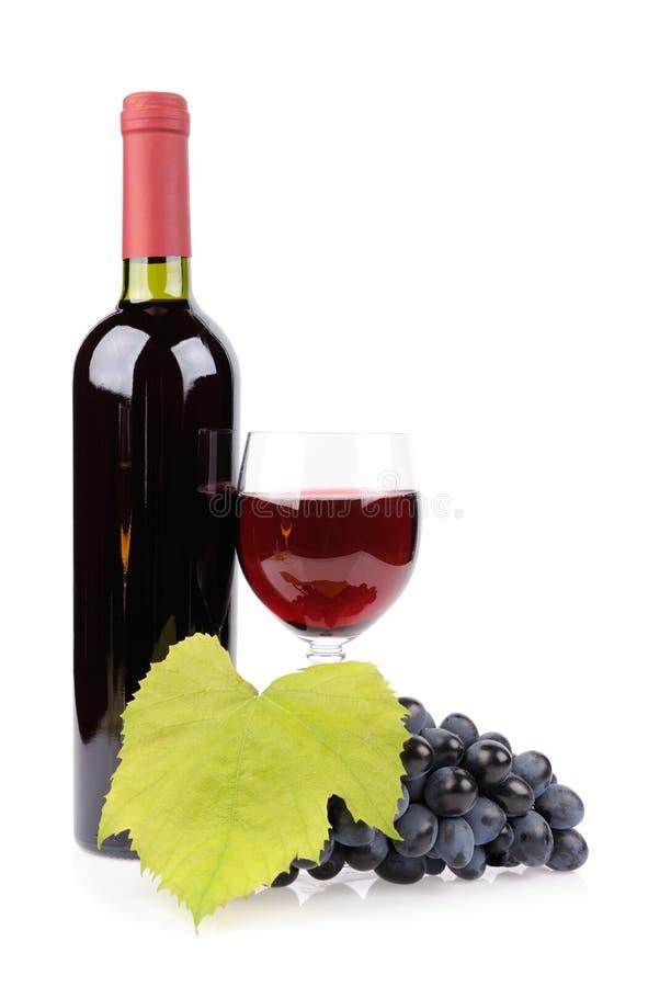 Botella, vidrio y uvas de vino fotografía de archivo