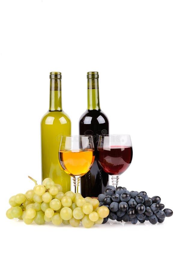 Botella, vidrio y uvas de vino fotografía de archivo libre de regalías