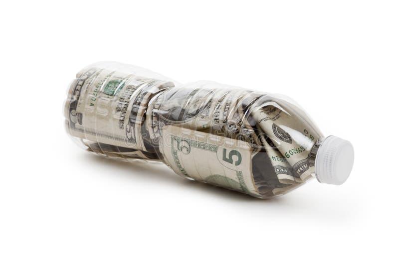 Botella y dólar plásticos imagenes de archivo