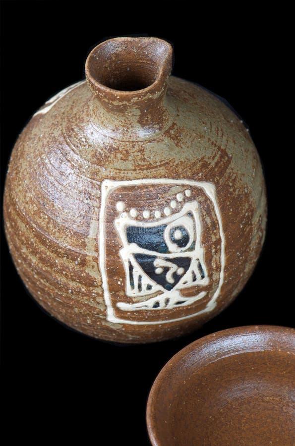 Botella y taza del motivo imagen de archivo libre de regalías