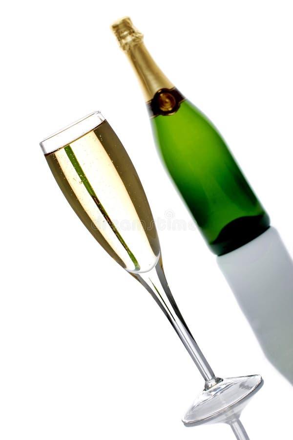 Botella y vidrio de champán foto de archivo libre de regalías