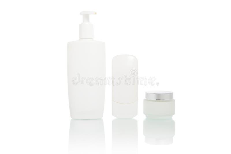 Botellas Blancas Fijadas (envase De La Higiene De La Belleza) Foto de archivo