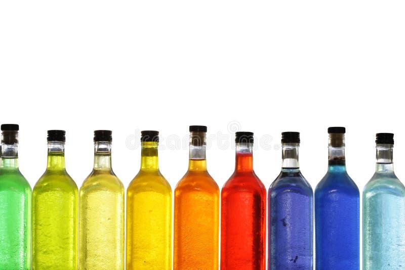 Botellas coloridas fotografía de archivo libre de regalías
