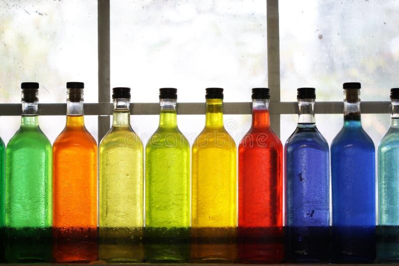 Botellas coloridas imágenes de archivo libres de regalías