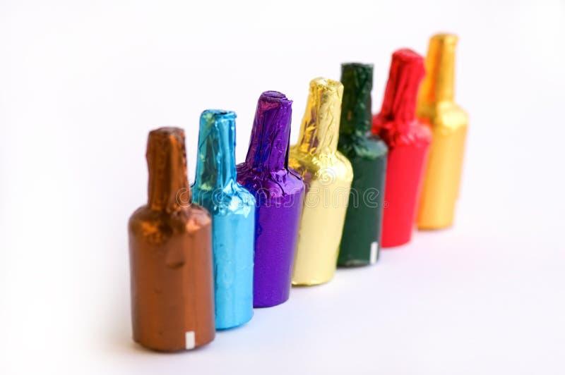 Download Botellas Coloridas Del Chocolate Imagen de archivo - Imagen de marrón, azul: 7279933