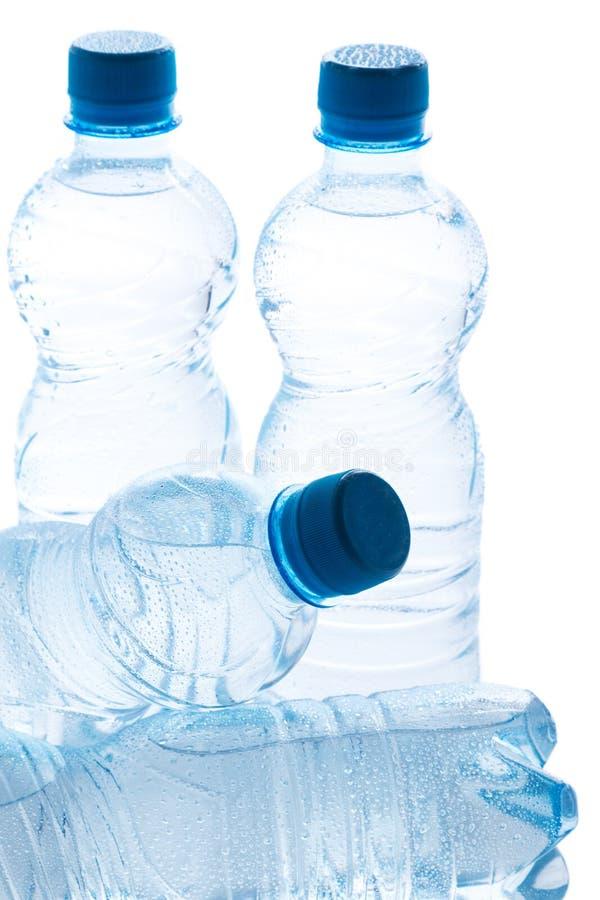 Botellas con agua imagen de archivo libre de regalías