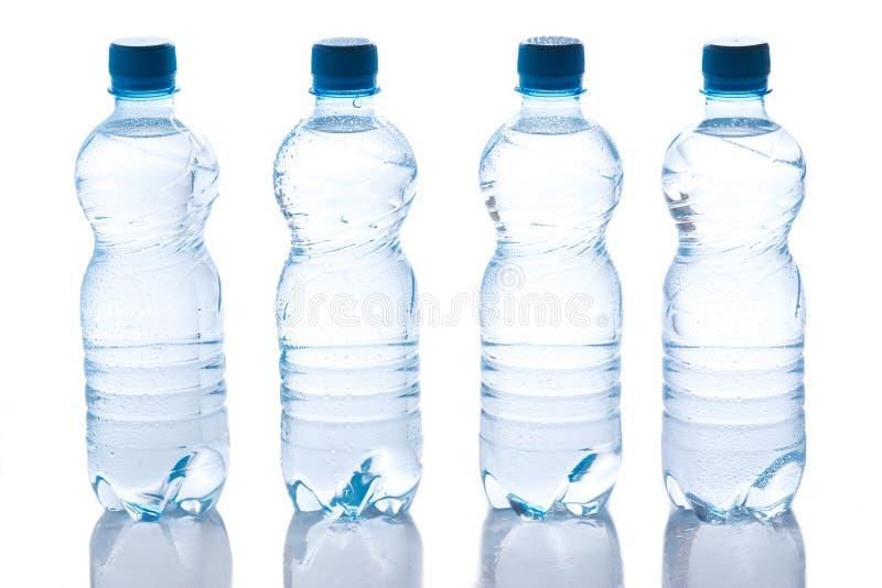 Botellas con agua imagen de archivo