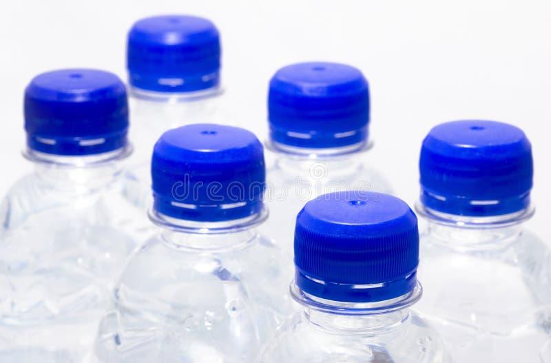 Botellas de agua imagenes de archivo