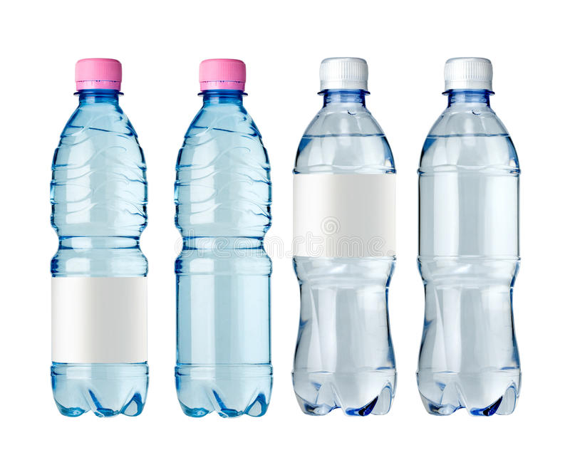 Botellas de agua con la escritura de la etiqueta foto de archivo libre de regalías